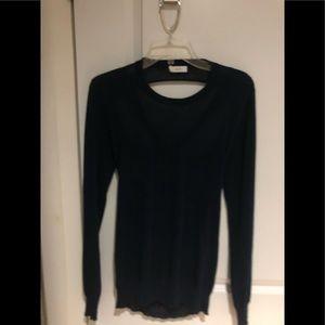 Long sleeve dark blue sweater.